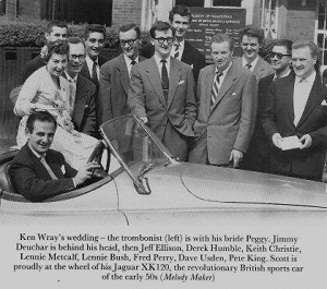 Ronnie Scott in his famous jaguar car with friends of the Jazz Club